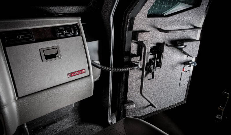 Picture of reinforced door hinges on armored 2017 Huron Kenworth T370 personnel carrier