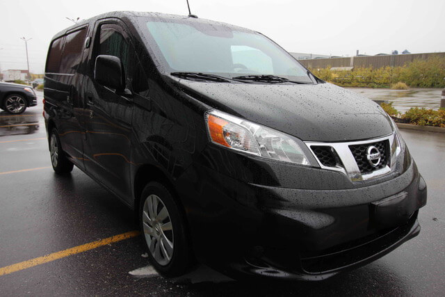Black armored Nissan NV 200 cash-in-transit cargo van picture