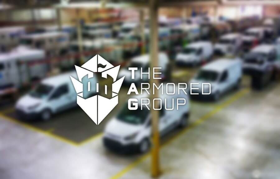 The Armored Group Featured Image Logo Over Blurry Warehouse Background