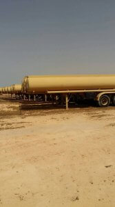Armored Group Unarmored Water/Fuel Tank Trailers sideview next each other
