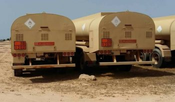 Armored Group Unarmored Water/Fuel Tank Trailers three parked on dirt