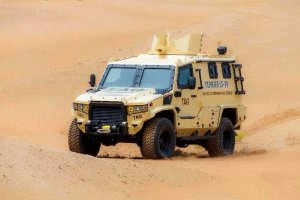 The Armored Group, LLC Introduces its Newest Vehicle, the Terrier Armored Personnel Carrier Driving Dessert Driver Corner Angle View