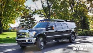 The Armored Group LLC Front Page Ford Truck Side Corner View Logo